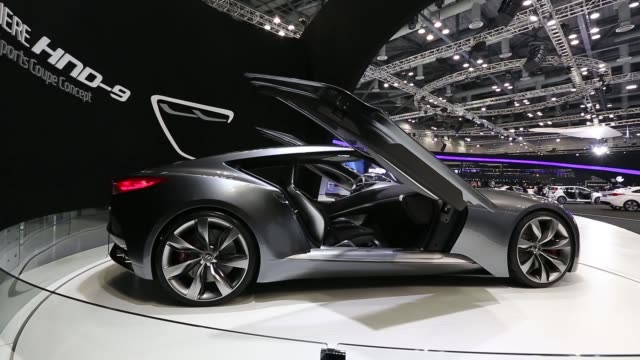 the hyundai motor co hnd9 concept vehicle stands on display during the press day of the seoul motor show in goyang an employee polishes the steering... - goyang stock videos and b-roll footage