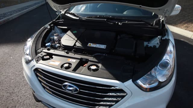 The Hyundai Motor Co hydrogenpowered Tucson crossover a vehicle propelled by electricity produced by a fuel cell stack is displayed outside the...