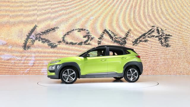 the hyundai motor co kona sport utility vehicle is displayed on stage during an unveiling ceremony in goyang south korea on tuesday june 13 chung eui... - goyang stock videos and b-roll footage