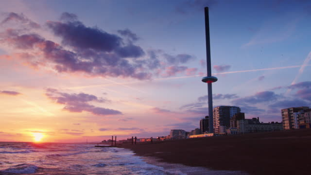 the i360, brighton at dusk - brighton brighton and hove stock-videos und b-roll-filmmaterial