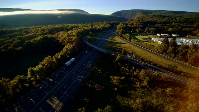 the i-80 columbus highway near by delaware water gap, at the border between new jersey and pennsylvania. aerial drone video footage. - pennsylvania stock videos & royalty-free footage