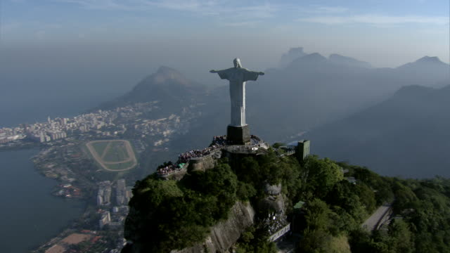 The iconic Christ the Redeemer statue stands on a narrow peak over Rio de Janeiro.