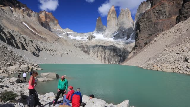 the iconic paine towers in torres del paine national park patagonia chile with tourists taking in the spectacle - steep stock videos & royalty-free footage