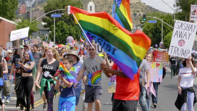 the iconic pride parade — a decades-old celebration of the lgbt community — was replaced this year with an anti trump protest march - gay rights stock videos & royalty-free footage