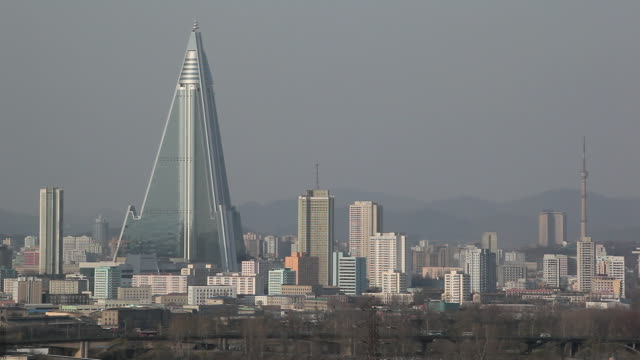 The iconic Ryugyong Hotel towers over the surrounding buildings.