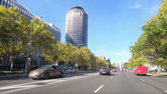 the iconic torre picasso and torre europa buildings rise from the azca complex on paseo de la castellan on october 9 in madrid spain azca considered... - leisure facilities stock videos & royalty-free footage