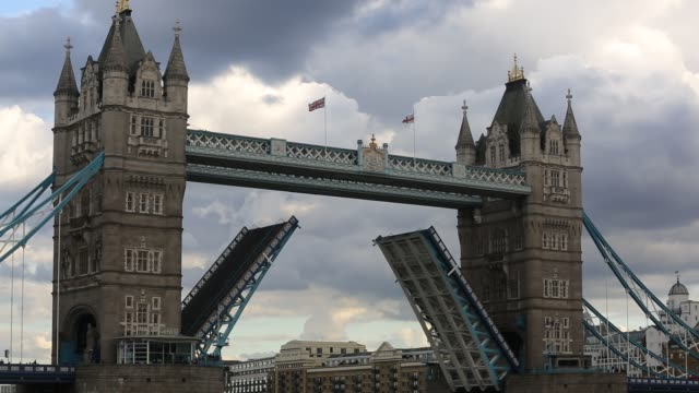 the iconic tower bridge spanning the river thames, opening to let a sailing boat down river, london, uk. - 19th century style stock videos & royalty-free footage