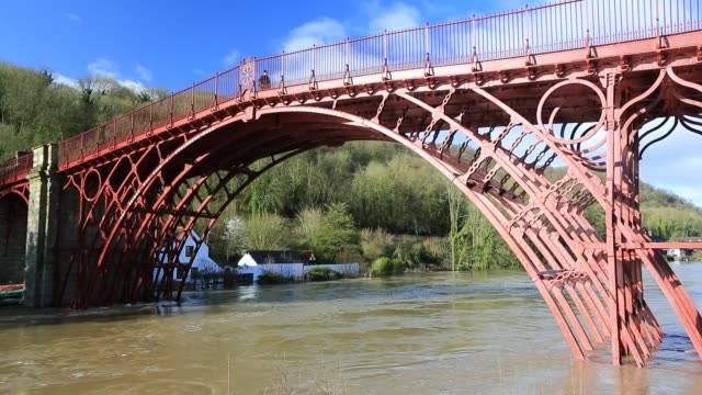 the iconic, worlds first iron bridge at ironbridge in shropshire, with the river severn in flood conditions after the wettest february on record in... - ironbridge shropshire stock videos & royalty-free footage