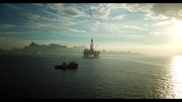 The idle Maua shipyard unfineshed Petrobras tankers and a Queiroz Galvao rig backdropped by Rio de Janeiro landscape in Niteroi Rio de Janeiro state...