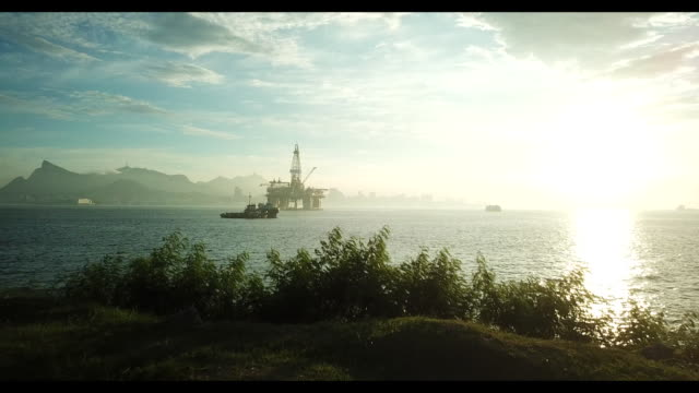 the idle maua shipyard unfineshed petrobras tankers and a queiroz galvao rig backdropped by rio de janeiro landscape in niteroi rio de janeiro state... - offshore platform stock videos & royalty-free footage