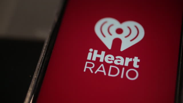 vídeos de stock, filmes e b-roll de the iheartmedia inc application is displayed for a photograph on an apple inc iphone in washington dc us on friday march 2 2018 embattled iheartmedia... - símbolo conceitual