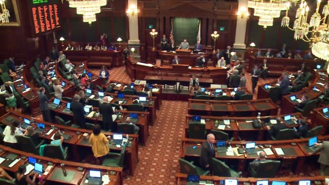 the illinois house voted 71-42 to override governor bruce rauner's veto of a budget plan after a hazmat situation forced a lockdown on july 6, 2017... - united states congress stock-videos und b-roll-filmmaterial