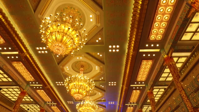 the illuminated ceilings of the conference hall feature traditional chinese style red and gold are two dominant colors inside the building - building feature stock videos & royalty-free footage