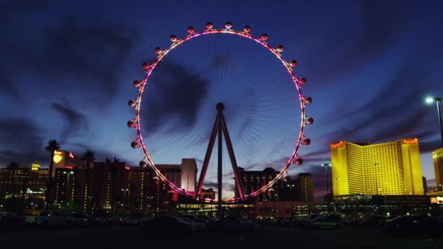vídeos y material grabado en eventos de stock de the illuminated high roller ferris wheel in full led illumination - big wheel