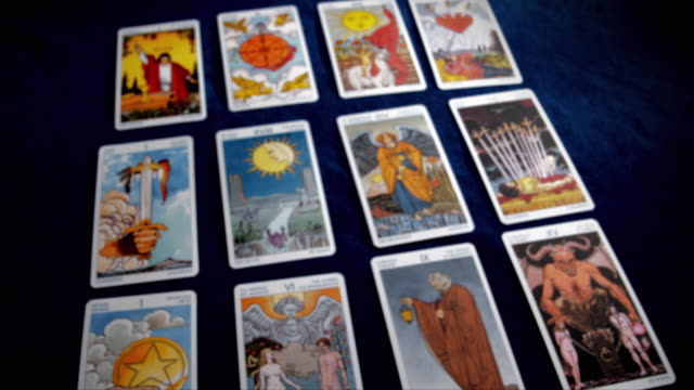 the images on a grid of tarot cards come into focus. - tarot cards stock videos & royalty-free footage