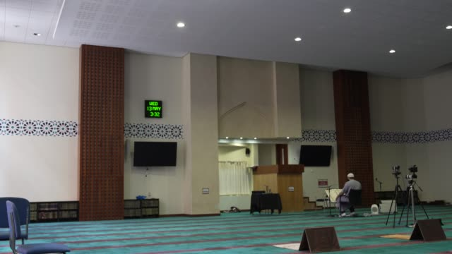 the imam – who you filmed doing the service in the mosque was called senior imam shaykh mohammed mahmoud. east london mosque is one – one of the... - mosque stock videos & royalty-free footage