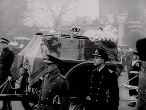 the imperial state crown sceptre and orb rests on top of king george vi's coffin as the funeral cortege leaves the houses of parliament 1952 - george vi of the united kingdom stock videos & royalty-free footage