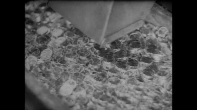 1940 the imprinting of new coins - money press stock videos and b-roll footage