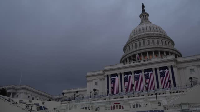 the inaugural stage is prepared for the inauguration of president-elect joe biden at dusk on january 16, 2021in washington, dc.. according to... - 大統領就任式点の映像素材/bロール