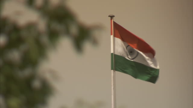 the indian flag waves in the breeze. - indian flag stock videos & royalty-free footage
