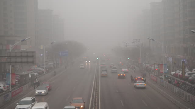 the industrial structure, energy consumption and traffic modes cause the severe air pollution in beijing, tianjin and surrounding areas. - luftverschmutzung stock-videos und b-roll-filmmaterial
