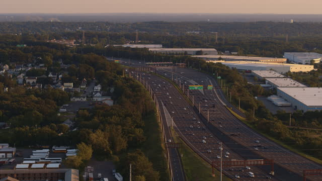 the industrial zone around the garden state parkway, new jersey, in the evening before the sunset. aerial video with the panning camera motion. - town stock videos & royalty-free footage