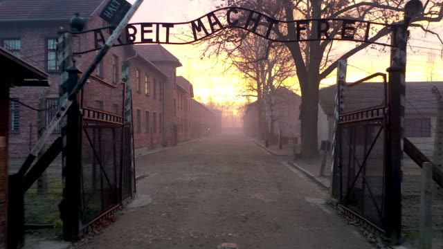 the infamous german inscription that reads 'work makes free' at the main gate of the auschwitz i extermination camp on on december 19, 2019 in... - concentration camp stock videos & royalty-free footage