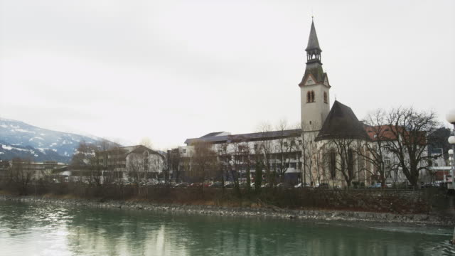 the inn river with the church of the district hospital of schwaz - inn river stock videos and b-roll footage