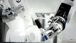 The innovative arms of a robotic arm make an injection of chemotherapy for a cancer patient. New technologies in medicine. Two manipulators draw medicine into a syringe. Hazardous substance injected.