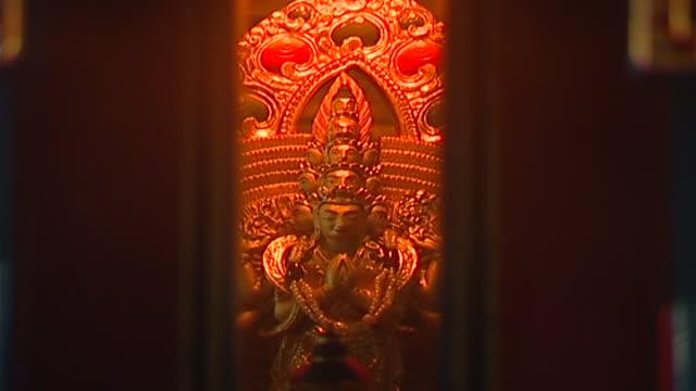 of the inside of a three-dimensional mandala, showing the bodhisattva of compassion, avalokiteshavara. - mandala stock videos & royalty-free footage