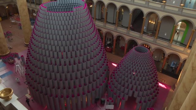 The installation dubbed Hive is made up of three domed structures using more than 2500 interlocking wound paper tubes