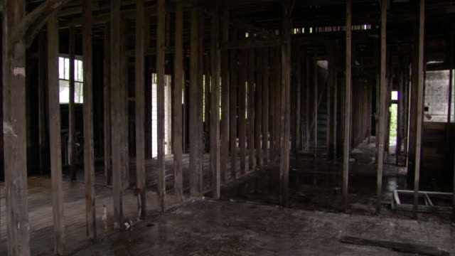 the interior of a building damaged by floods after hurricane katrina is gutted out. - hurricane katrina stock videos and b-roll footage