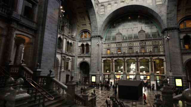 the interior of antwerp central station features arched columns and ceilings in belgium. - station stock videos & royalty-free footage