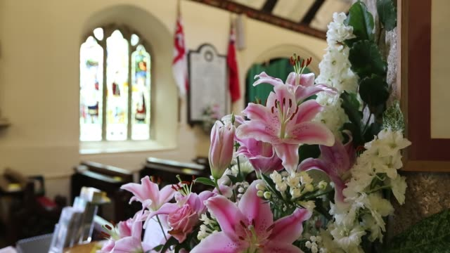 the interior of cornwall's famous st just in roseland church in cornwall, united kingdom on august 20, 2015. - lilium stargazer stock-videos und b-roll-filmmaterial