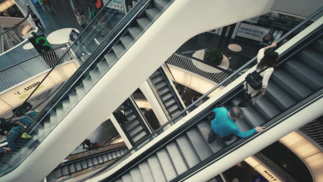 the interior of the myzeil shopping mall in frankfurt, germany - rolltreppe stock-videos und b-roll-filmmaterial