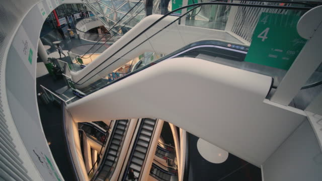 the interior of the myzeil shopping mall in frankfurt, germany - architettura video stock e b–roll