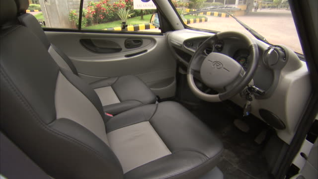 the interior of the reva electric car features bucket seats. - car interior stock videos & royalty-free footage