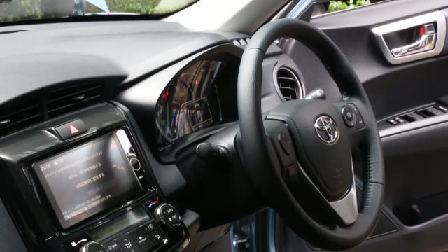 the interior of the toyota motor corp. corolla axio hybrid vehicle is seen at its unveiling in tokyo, japan, on tuesday, august 6 the steering wheel... - fielder stock videos & royalty-free footage