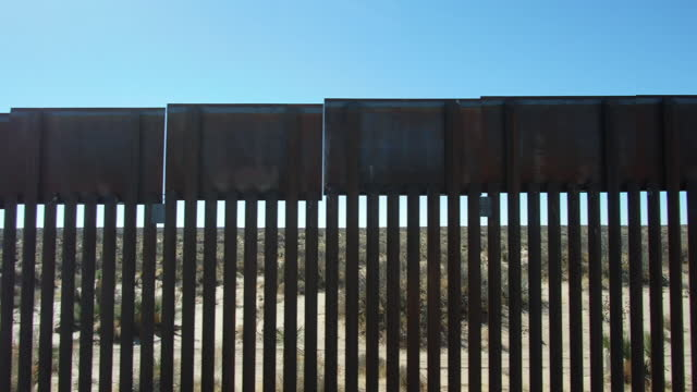 the international border wall between mexico and the united states - emigration and immigration stock videos & royalty-free footage