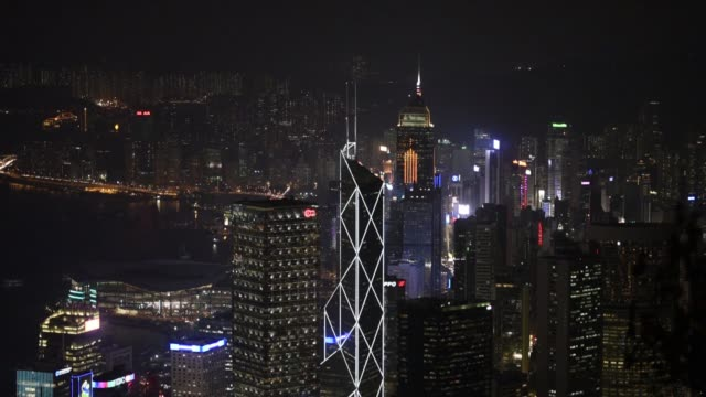 the international finance centre , center, and other buildings stand illuminated at night in hong kong, china on friday, nov 27 the bank of china... - bank of china tower hong kong stock videos & royalty-free footage