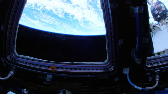 the international space station (iss) cupola's view of our planet earth - indoors stock videos & royalty-free footage
