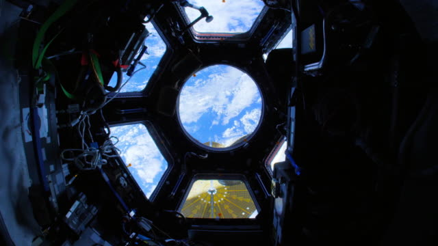the international space station (iss) cupola's view of our planet earth - 宇宙航空機点の映像素材/bロール