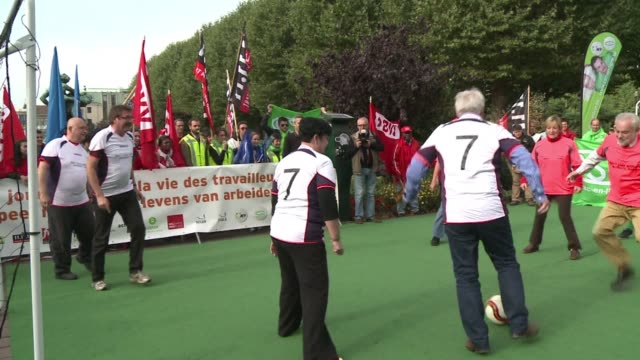 the international trade union confederation holds a symbolic football match to draw attention to allegations of appalling working conditions in the... - international match stock videos & royalty-free footage