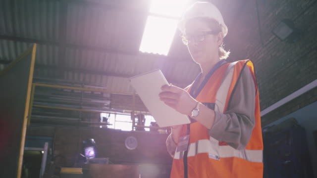 the internet is a valuable tool for any engineer - building contractor stock videos & royalty-free footage