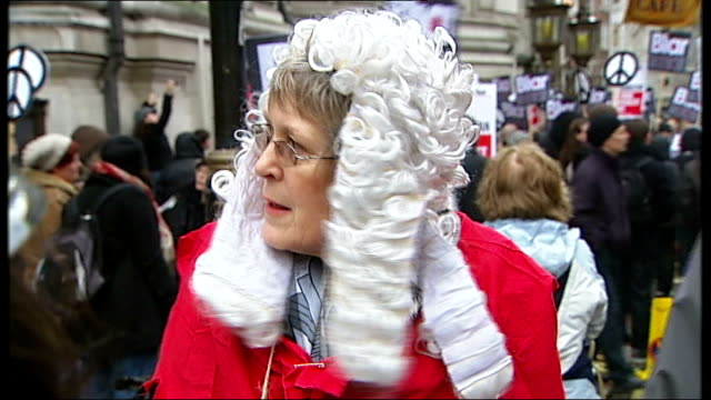 demonstrations as tony blair testifies at chilcot inquiry england london queen elizabeth ii conference centre ext / raining 'killed in iraq' poster... - for sale englischer satz stock-videos und b-roll-filmmaterial