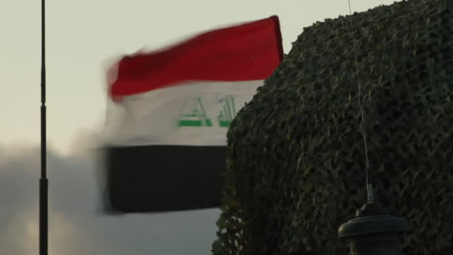 the iraqi flag blowing in the wind in western mosul - iraqi flag stock videos and b-roll footage