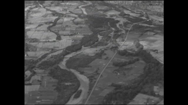 the ishikari river winds through the hokkaido countryside. - kamikawa district ishikari stock videos and b-roll footage