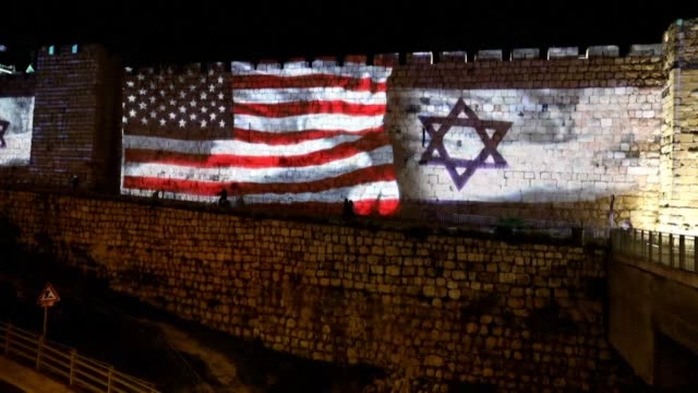 the israeli and united states flags are projected on the walls of the ramparts of jerusalem's old city to celebrate close ties between the two... - jerusalem stock videos & royalty-free footage