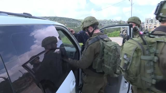 vídeos de stock e filmes b-roll de the israeli army closes access to the village of burquin in the occupied west bank following an attack that killed an israeli and wounded two others... - southwest usa