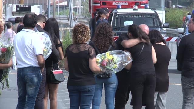 the italian city of genoa holds a minute's silence a month after the morandi bridge collapse killed 43 people - bro bildbanksvideor och videomaterial från bakom kulisserna